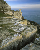 View of the rocky cliff edge and sea from St. Aldhelm's Head in Dorset