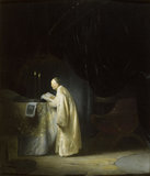A PRIEST AT AN ALTAR attributed to Rembrandt