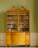 One of a pair of satinwood bookcases in the saloon at Dunham Massey, probably dating from c 1790