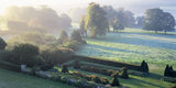 Misty view across the park and sunken garden at Hinton Ampner in October