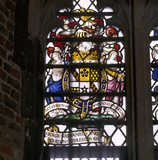 An heraldic stained glass window commissioned by Lord Curzon to commemorate the later owners of Tattershall