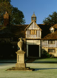 View of what were once thought to be Elizabethan Cottages, at Ightham Mote, Kent,  with a sundrenched urn in the forefront