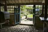 Looking through the garden house at Snowshill Manor, Gloucestershire, UK into the Well Court