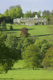 A view of the south front of Polesden Lacey, a Regency House near Dorking, Surrey with the valley and parkland below