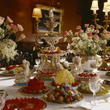 Close view of food and flowers in the Dining Room at Penrhyn Castle