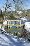 The Palladian Bridge at Prior Park Landscape Garden, Bath, under a dusting of snow