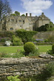 The West front of Snowshill Manor, Gloucestershire, UK with the garden and terrace in the foreground