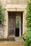 An open door with a view inside, at Mottisfont Abbey