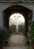 View through the Tower arch at Sissinghurst Castle Garden on a misty morning