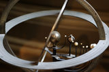An armillary helicentric planetarium, French, C19th, in Admiral at Snowshill Manor, Gloucestershire