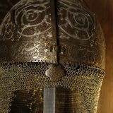 Detail of a steel Indo-Persian helmet with chain mail and a nasal guard, part of the Charles Wade collection, in Seraphim at Snowshill Manor, Gloucestershire