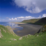 Rhossili Bay on the Gower Peninsula in South Wales, the view down to the empty beach with Rhossili Down on the right