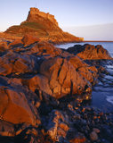 View of the rocky causeway under Lindisfarne Castle taken in the afternoon light
