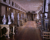 View of the Long Gallery at Powis Castle showing the full length of the gallery and plasterwork ceiling decorated with stuccoed figures
