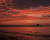 St.Michael's Mount beneath a dramatic vivid red dawn sky