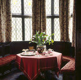 The bay window in the oak Drawing Room with the table laid for a Victorian tea