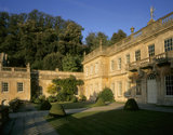 Sunlight shines down onto the West Front of Dyrham Park on a beautiful Autumn's day