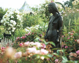 The statue of Fair Rosamund in the Rose Labyrinth in the Walled Garden at Coughton Court, Warwickshire, created and managed by the Throckmorton Family