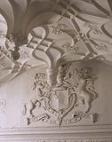 A partial view of the plasterwork arms of Henry FitzAlan, 24th and last FitzAlan Earl of Arundel and Knight of the Garter, showing part of the frieze and barrel ceiling in the Great Chamber at Trerice
