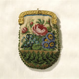 View of a beaded purse with a floral decoration from the 1850's