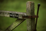 Signs on a gate at the Brockhampton Estate