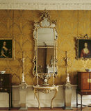 The interior of the Drawing Room with its gilt mirror and side table and 18th Century, Italian designed wallpaper