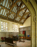 Room view of the Great Hall with the elaborate wooden wind brace and cornice roof, wooden screen restored by Sir Walter Jenner in medieval style and stained glass windows attrib