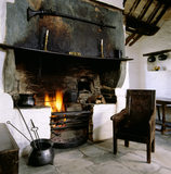 The fireplace in the Hall in the Tintagel Old Post Office, now restored to show how it looked when used as a post office in the 19th century