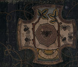 A motif from the Marian Needlework at Oxburgh Hall showing a spider in its web in the centre with others in side sections