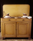 C19th servants' washstand at Dunham Massey, painted in the house- style, yellow