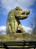 Mossy stone heraldic beast (Boar) at the entrance to Charlecote Park, Warwickshire