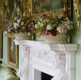 The chimney-piece in the Long Gallery at Osterley Park with baskets of flower arrangements