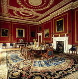 Dining Room from the Entrance Hall door to Inner Library door, with a suite of dining chairs by Gillows, English carpet C1800, French ormolu tableware and plaster ceiling by Joseph Bromfield