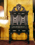 A cabinet and stand in ebony with mother of pearl inlay, attributed to Herman Doomer (c. 1595-1650), in The Argory.