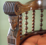 A close-up detail of an Egyptian head on a Chippendale armchair made in 1805