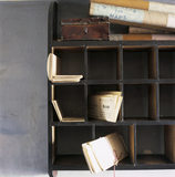 Close view of pigeon hole shelves in W.M.Heelis' Offices, now Beatrix Potter Gallery, containing leases and other documents, with a wooden box and rolled Stanford maps on the top.