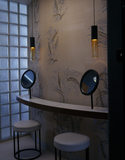 The Powder Room in The Homewood designed by Patrick Gwynne to avoid his sister Noreen having to share her bedroom with guests; the wall is hand-painted silk and the side walls glass block