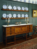 The sideboard probably by Llewellyn Rathbone in the Dining Room at Standen