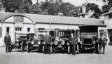 Chauffeurs and mechanics with Mrs Greville's fleet of cars in the stables at Polesden Lacey
