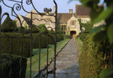 Looking through the gate towards the Apostles topiary and Lytes Cary Manor