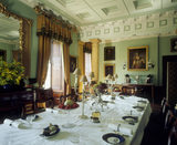 The Dining Room at Erddig, designed by Thomas Hopper in 1826, the table is set for dinner
