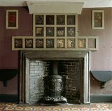 Painted coats of arms, above the fireplace, in the Tribes' Room at Erddig