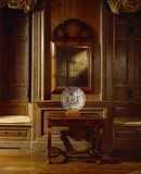 A view of a walnut pier table and pier glass decorated with a 'seeweed' marquetry pattern in the Drawing Room at Beningbrough Hall