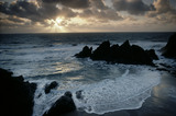 View from Bolt Head to Bolt Tail with waves breaking on shore at Soar Mill Cove with sunset, Devon