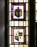 The staircase half landing - armorial stained-glass panels representing late C18th and early C19th marriage alliances of the Dryden family over 400 years