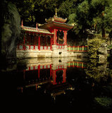 View of the Chinese temple from across the pool in the Chinese garden at Biddulph Grange