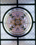 Detail of glass ceiling light featuring a round painted panel with floral design in the centre, in the Upstairs Lobby off the Staircase Hall at Sunnycroft