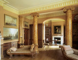 The library, decorated in early 19th century style with a pair of scagliola columns and a pair of chaise longues