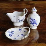 Tea caddy, cream jug and sugar dish with blue flower design