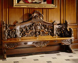 A carved walnut bench in the Great Hall at Dunham Massey,17th C, possibly Dutch or English